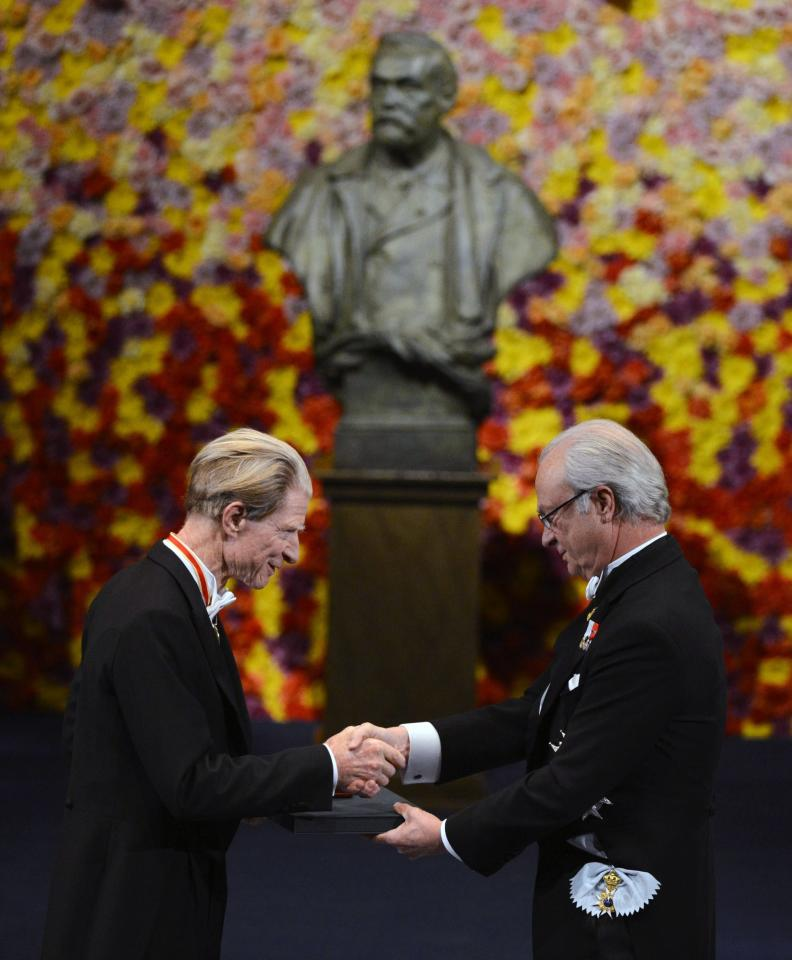 The 2012 Nobel Prize Laureate for Physiology or Medicine Dr John B. Gurdon, left, of Great Britain receives his Nobel Prize from Sweden's King Carl XVI Gustaf during the Nobel Prize award ceremony at the Stockholm Concert Hall in Stockholm, Sweden Monday, Dec. 10, 2012. The Nobel awards are always awarded on Dec. 10, the anniversary of Alfred Nobel's death in 1896. The prizes for laureates in medicine, chemistry, physics and literature are awarded in the Swedish capital Stockholm, whilst the Nobel Peace Prize is awarded on the same day in Oslo, Norway. (AP Photo/Henrik Montgomery, Pool)
