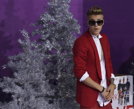 """Bieber poses at the premiere of the documentary """"Justin Bieber's Believe"""" in Los Angeles"""