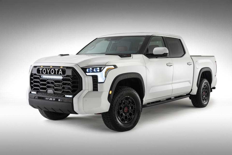 This photo provided by Toyota shows the 2022 Toyota Tundra TRD. Toyota is dumping the big V8 engine in the latest redesign of its Tundra full-size pickup truck, a bold move in a market that likes big, powerful engines. The 381 horsepower, 5.7-liter V8 will be replaced by a base 389 horsepower 3.5-liter twin-turbo V6. (Toyota via AP)