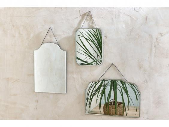 Create the illusion of space with a hanging mirror above your desk (Nkuku)