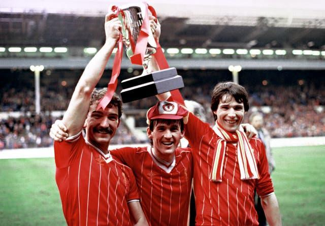 Graeme Souness (left), Kenny Dalglish and Alan Hansen celebrate with the Milk Cup