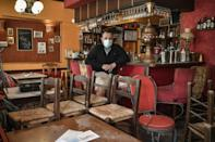 Tilemachos Nikoletatos. posing in his closed bistro, has been forced to downsize