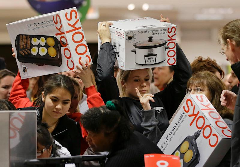 Shoppers rush to grab electric griddles and slow cookers on sale for $8 shortly after the doors opened at a J.C. Penney on Black Friday, Nov. 23, 2012, in Las Vegas.