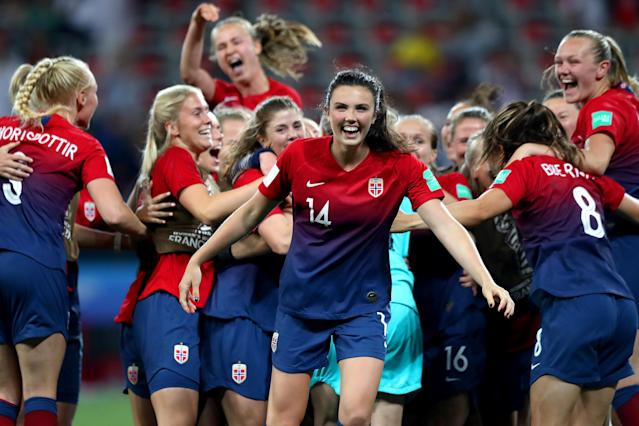 Norway celebrates after Ingrid Engen (14) converted her penalty kick to send them past Australia and into the Women's World Cup quarterfinals. (Getty)