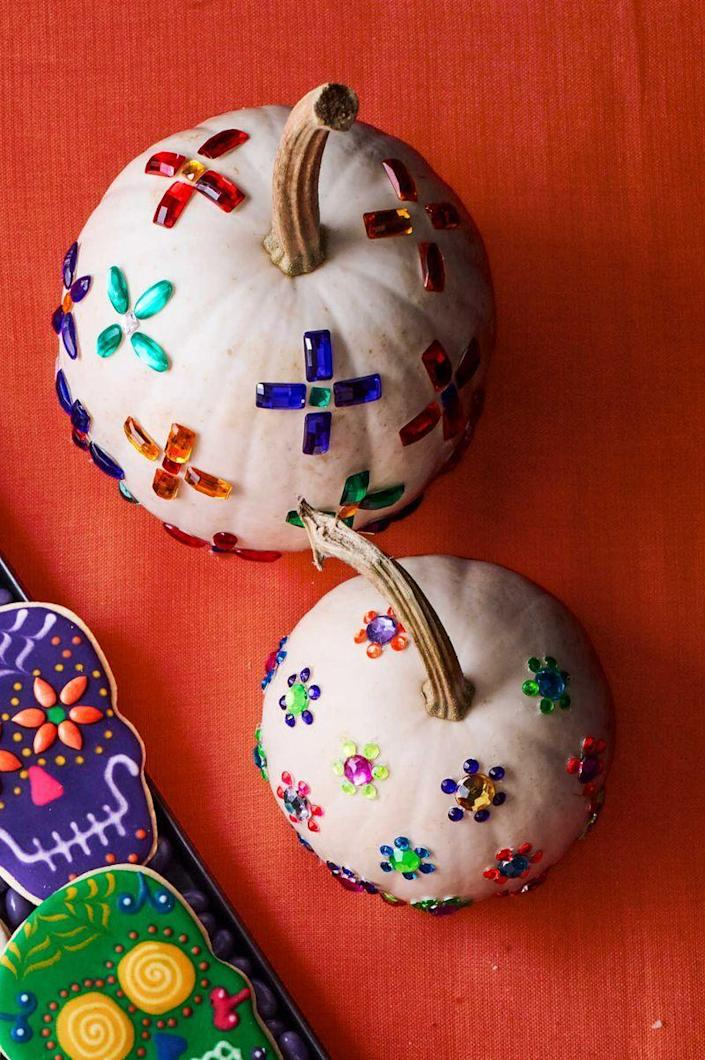 """<p>Host a pumpkin decorating party and spread out adhesive jewels, so your guests can let their creativity run free. </p><p><strong>What You'll Need</strong>: <a href=""""https://www.amazon.com/Self-Adhesive-Rhinestones-Bulk-Pack-Embellishments/dp/B01NAP5TPR/?tag=syn-yahoo-20&ascsubtag=%5Bartid%7C10070.g.1908%5Bsrc%7Cyahoo-us"""" rel=""""nofollow noopener"""" target=""""_blank"""" data-ylk=""""slk:Self-adhesive jewels"""" class=""""link rapid-noclick-resp"""">Self-adhesive jewels</a> ($14, Amazon)</p>"""