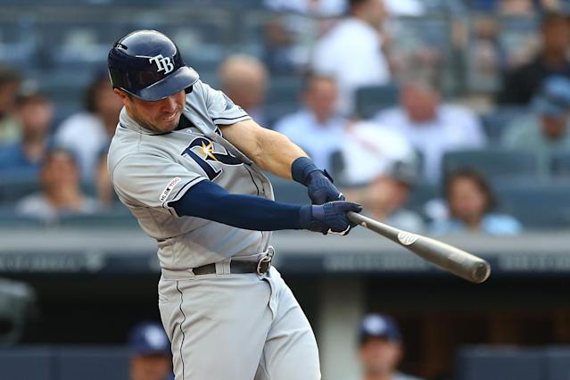 Travis d'Arnud homers Monday, his first of three. (Mike Stobe/Getty Images)