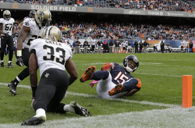 Chicago Bears wide receiver Brandon Marshall (15) makes a touchdown reception in the end zone during the second half of an NFL football game against the New Orleans Saints, Sunday, Oct. 6, 2013, in Chicago.(AP Photo/Nam Y. Huh)