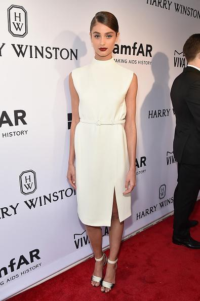Taylor Hill might be a Victoria's Secret model, but she was all covered up in a classy Ralph Lauren dress. The white dress with mock neck and belt was vamped up with a dark lip and her hair slicked into side part and pulled into a ponytail.