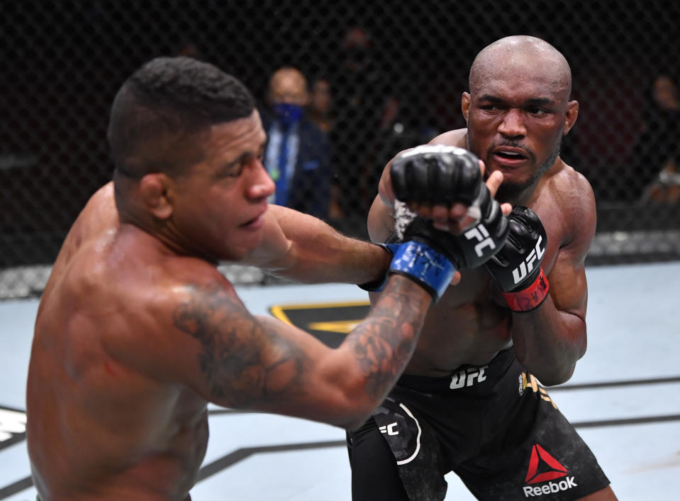 LAS VEGAS, NEVADA - FEBRUARY 13: In this handout image provided by UFC, (R-L) Kamaru Usman of Nigeria punches Gilbert Burns of Brazil in their UFC welterweight championship fight during the UFC 258 event at UFC APEX on February 13, 2021 in Las Vegas, Nevada. (Photo by Jeff Bottari/Zuffa LLC via Getty Images)