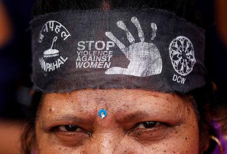 A woman wears a bandana with a message, during a protest organised by the Delhi Commission for Women, against the rape of an eight-year-old girl, in Kathua, near Jammu and a teenager in Unnao, Uttar Pradesh state, in New Delhi, India April 13, 2018. REUTERS/Saumya Khandelwal