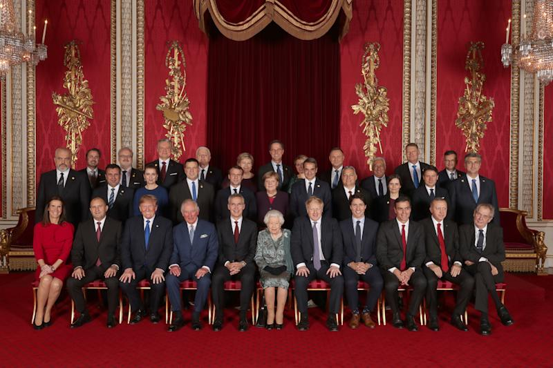 Queen Elizabeth posing with the Nato leaders on Tuesday. (PA)