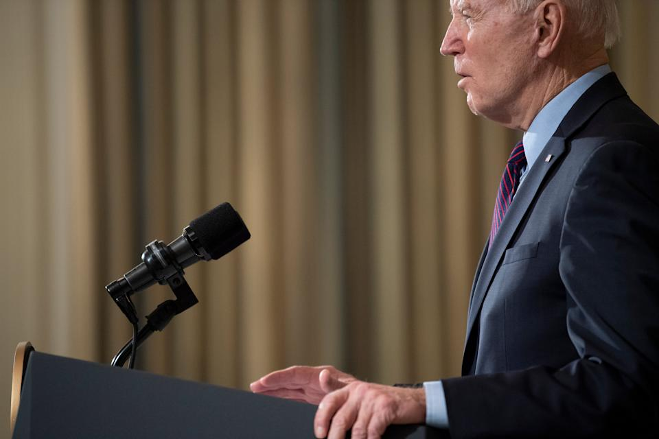 US President Joe Biden speaks about Covid-19 relief from the State Dining Room of the White House February 5, 2021, in Washington, DC. (Photo by Brendan Smialowski / AFP) (Photo by BRENDAN SMIALOWSKI/AFP via Getty Images)
