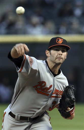 Baltimore Orioles starting pitcher Jake Arrieta throws to the Chicago White Sox during the first inning of a baseball game, Monday, April 16, 2012, in Chicago. (AP Photo/John Smierciak)