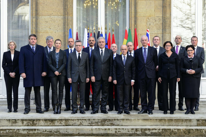 French Interior Minister Bernard Cazeneuve flanked by colleagues following a G9 meeting on security on January 11, 2015 (AFP Photo/Yves Malenfer)