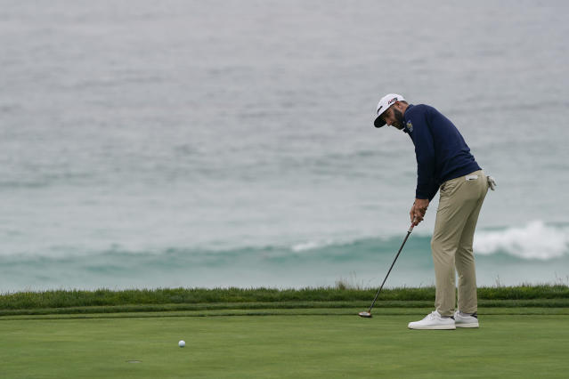Dustin Johnson putts on the 10th hole during a practice round for the U.S. Open Championship golf tournament Wednesday, June 12, 2019, in Pebble Beach, Calif. (AP Photo/David J. Phillip)