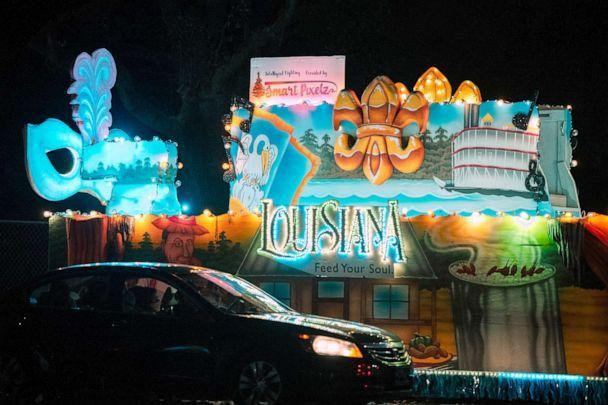 PHOTO: Vehicles line up to view Mardi Gras floats at the Vehicles line up to view Mardi Gras floats at the Float in the Oaks event in City Park, Feb. 14, 2021, in New Orleans, Louisiana. (Jon Cherry/Getty Images)