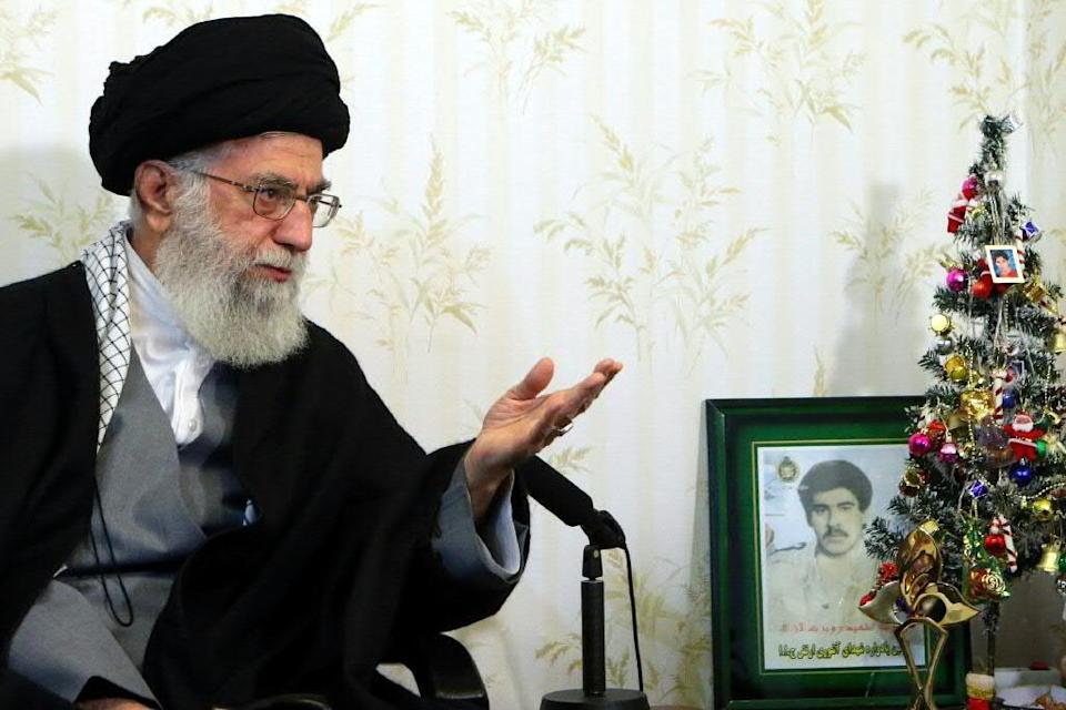 """Ali Khamenei says the United States is seeking to influence next month's elections in the Islamic republic but such efforts will receive a """"punch in the mouth"""" (AFP Photo/)"""