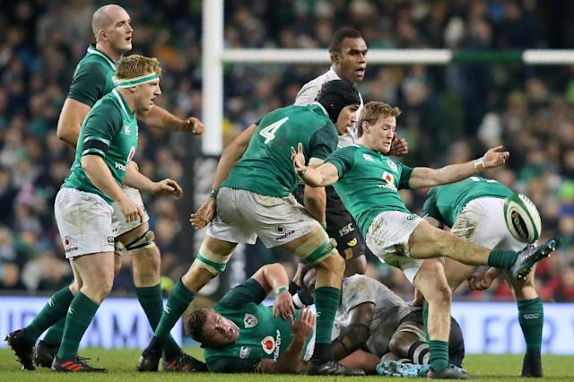 Ireland's scrum-half Kieran Marmion (R) kicks the ball up-field during their rugby union Test match against Fiji, at Aviva stadium in Dublin, on November 18, 2017 (AFP Photo/Paul FAITH)