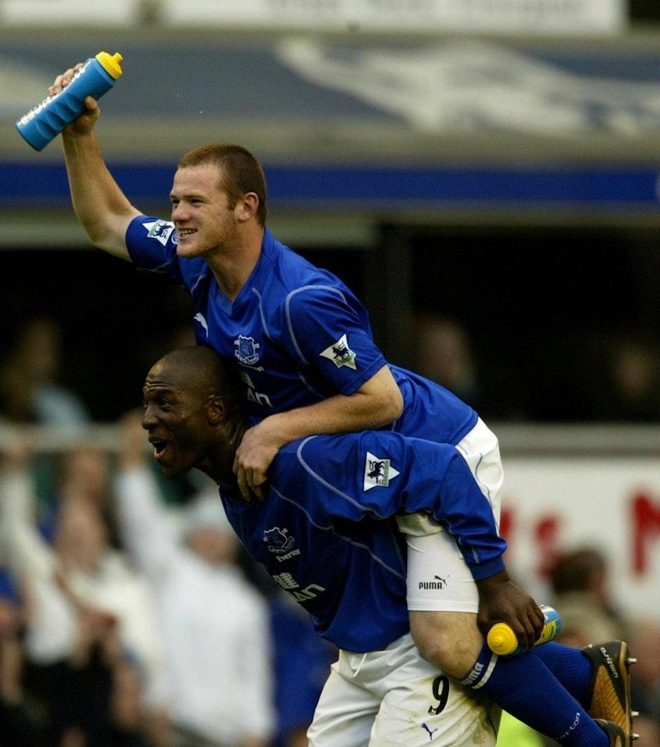 A 16-year-old Wayne Rooney (top) celebrates his late winner in Everton's 2-1 victory over Arsenal in 2002 (Nick Potts/PA). (PA Archive)