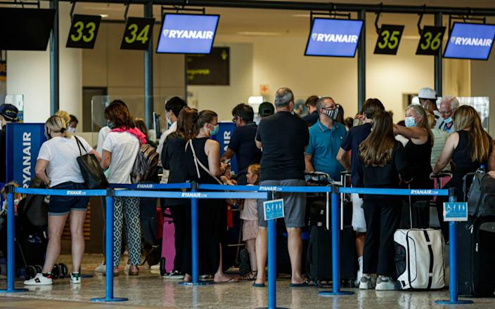 British people gather at Faro Airport as they interrupt their holidays in the Algarve to return home due to the British government's new quarantine rules about the COVID-19 pandemic, in Faro, Portugal, 07 June 2021. Portugal will be removed from Britain's green travel list from 08 June amid rising coronavirus disease (COVID-19) cases and concern over new virus variants. British tourists interrupt holidays in the Algarve, Portugal, Faro - 07 Jun 2021 - LUIS FORRA/EPA-EFE/Shutterstock