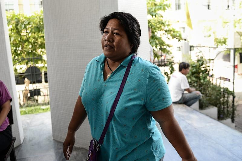 """Patnaree Chankij, the mother of pro-democracy activist Sirawith """"Ja Niew"""" Seritiwat, arrives at a military court in Bangkok on August 1, 2016"""