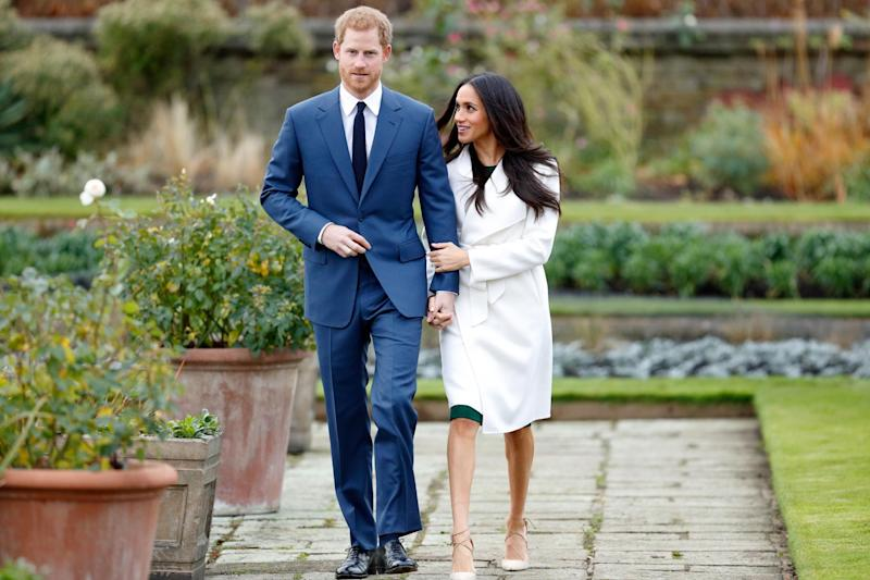 Prince Harry and Meghan Markle hold hands after announcing their engagement in London, England on November 27, 2017. (Getty Images)