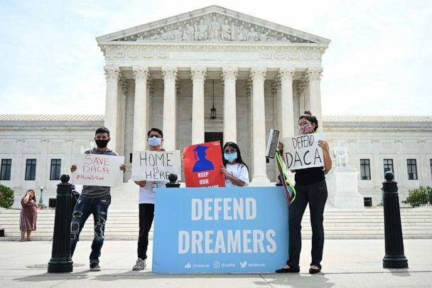 PHOTO: In this file photo Deferred Action for Childhood Arrivals (DACA) demonstrators stand outside the US Supreme Court in Washington, D.C., June 15, 2020. (Jim Watson/AFP via Getty Images, FILE)