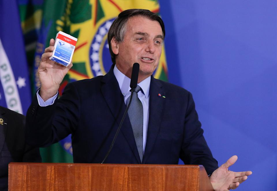 Brazilian President Jair Bolsonaro speaks holding a hydroxychloroquine box during the inauguration ceremony of Army General Eduardo Pazuello as Minister of Health at the Planalto Palace, in Brasilia, on September 16, 2020. - Pazuello was acting minister for the past 3 months. (Photo by Sergio Lima / AFP) (Photo by SERGIO LIMA/AFP via Getty Images)