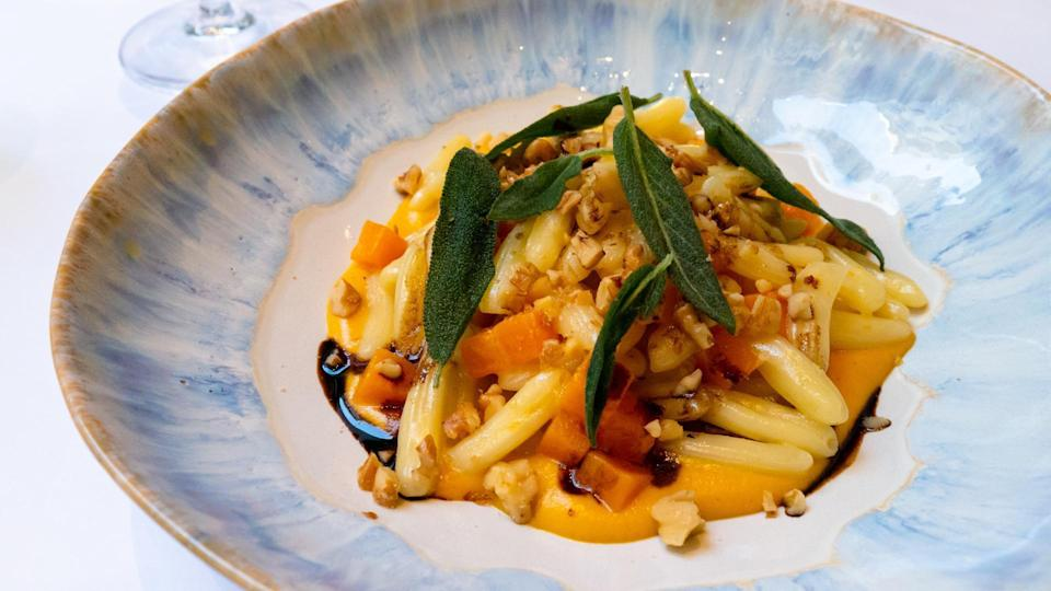 """<p>This butternut squash cavatelli is bursting with autumnal flavor, but it's good any time of year. If you want it to be particularly tasty, check out when squash is in season in <a href=""""https://www.thedailymeal.com/healthy-eating/monthly-guide-seasonal-produce?referrer=yahoo&category=beauty_food&include_utm=1&utm_medium=referral&utm_source=yahoo&utm_campaign=feed"""" rel=""""nofollow noopener"""" target=""""_blank"""" data-ylk=""""slk:our monthly produce guide"""" class=""""link rapid-noclick-resp"""">our monthly produce guide</a>.</p> <p><a href=""""https://www.thedailymeal.com/recipes/butternut-squash-cavatelli-recipe?referrer=yahoo&category=beauty_food&include_utm=1&utm_medium=referral&utm_source=yahoo&utm_campaign=feed"""" rel=""""nofollow noopener"""" target=""""_blank"""" data-ylk=""""slk:For the Butternut Squash Cavatelli recipe, click here."""" class=""""link rapid-noclick-resp"""">For the Butternut Squash Cavatelli recipe, click here.</a></p>"""