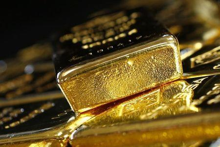 Gold prices hit day's highs on softer dollar