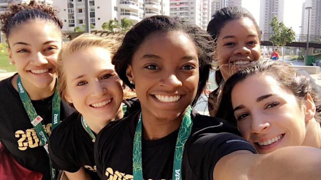 """<p>The new 'Fierce Five' squad squeezes into frame for a selfie at the Rio Olympic Village. (At 4′ 8″, Simone Biles is a whole two feet shorter than U.S. volleyball player David Lee. But, as Biles, tweeted, """"size difference in olympians doesn't matter."""" (@Simone_Biles/Twitter) </p>"""