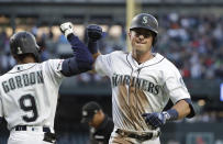 Seattle Mariners' Dylan Moore, right, is congratulated by Dee Gordon on his solo home run against the St. Louis Cardinals during the fifth inning of a baseball game Wednesday, July 3, 2019, in Seattle. (AP Photo/Elaine Thompson)