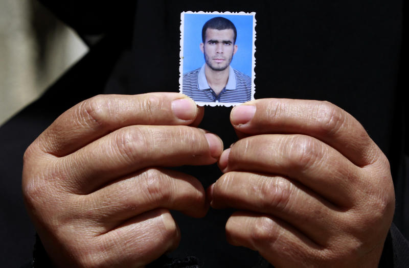 A relative of Ahmed Abu Nasr shows his photograph at his home in Khan Younis Refugee Camp, Friday, June 1, 2012.  Abu Nasr and an Israeli soldier were killed in a shootout  near the border with the Gaza Strip early Friday, the Israeli military said. The exchange of fire began after the militant crossed the fence separating the Hamas-run coastal strip and southern Israel. (AP photo/Hatem Moussa)