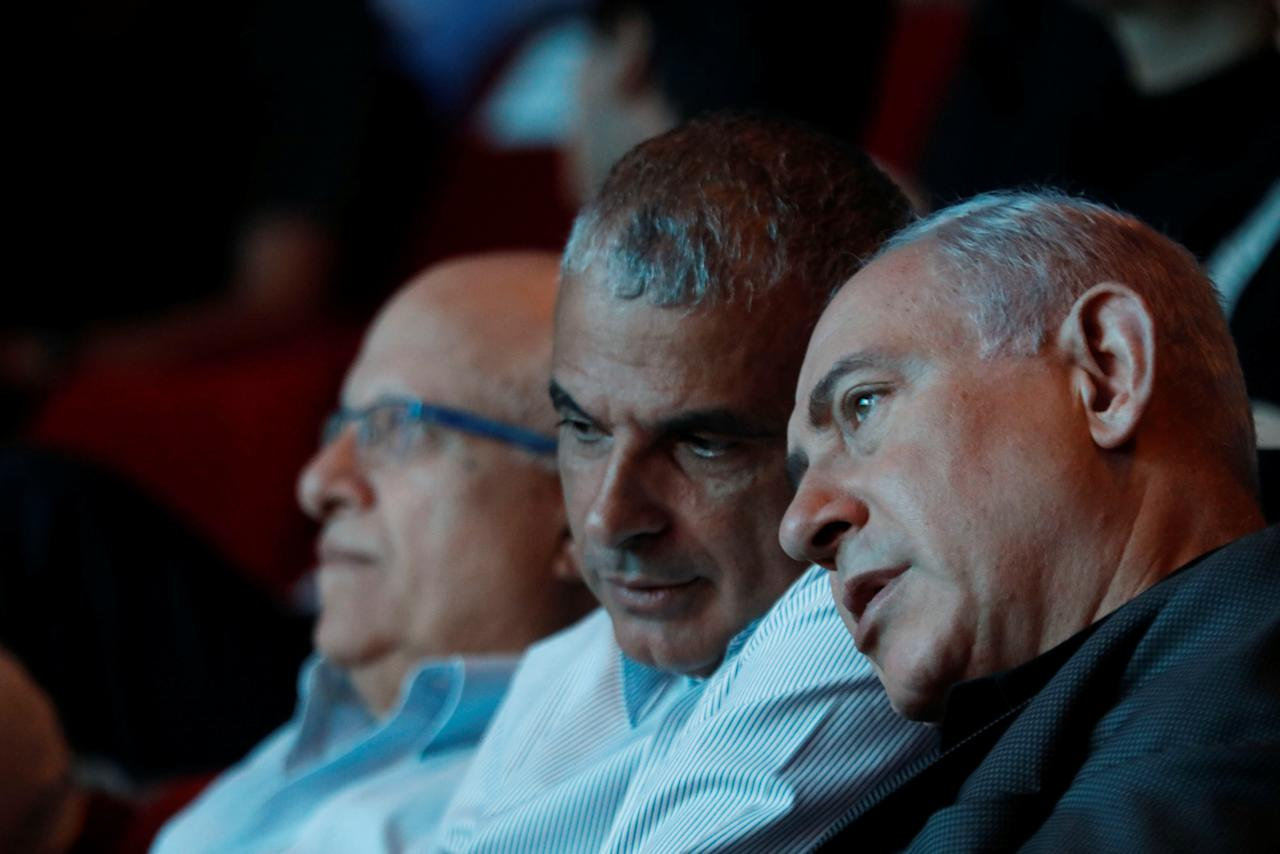 Israeli Prime Minister Benjamin Netanyahu (R) sits next to Israeli Finance Minister Moshe Kahlon (C) during an event in Ofakim, southern Israel May 29, 2017. REUTERS/Amir Cohen