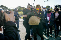 The family of slain Italian doctoral student Giulio Regeni, from right, Giulio's sister Irene, mother Paola Deffendi, and father Claudio Regeni, arrive arrive with their lawyer Alessandra Ballerini at the Rebibbia prison in Rome, Thursday, Oct. 14, 2021, to attend the first hearing of the trial for the death of Italian doctoral student Giulio Regeni, who disappeared for several days in January 2016 before his body was found on a desert highway north of the Egyptian capital. Italian prosecutors have formally put four high-ranking members of Egypt's security forces under investigation for their alleged roles in the slaying. (AP Photo/Andrew Medichini)
