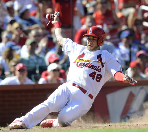 St. Louis Cardinals' Tony Cruz (48) scores on an RBI single by teammate Pete Kozma against the Chicago Cubs in the sixth inning in a baseball game, Sunday, Aug. 11, 2013, at Busch Stadium in St. Louis. (AP Photo/Bill Boyce)