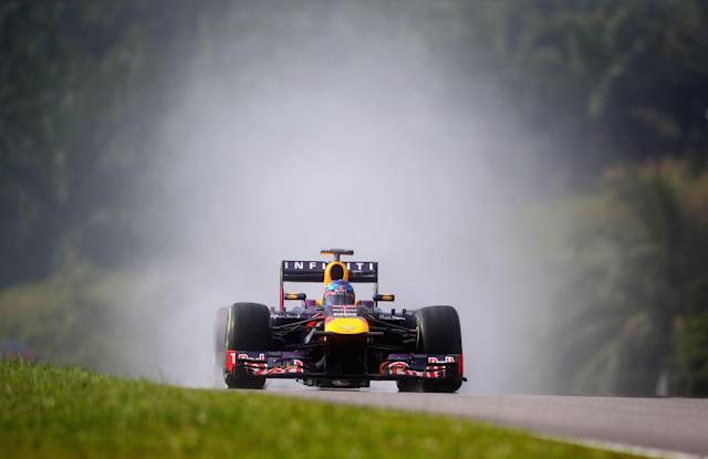 KUALA LUMPUR, MALAYSIA - MARCH 23: Sebastian Vettel of Germany and Infiniti Red Bull Racing drives on his way finishing first during qualifying for the Malaysian Formula One Grand Prix at the Sepang Circuit on March 23, 2013 in Kuala Lumpur, Malaysia. (Photo by Clive Mason/Getty Images)