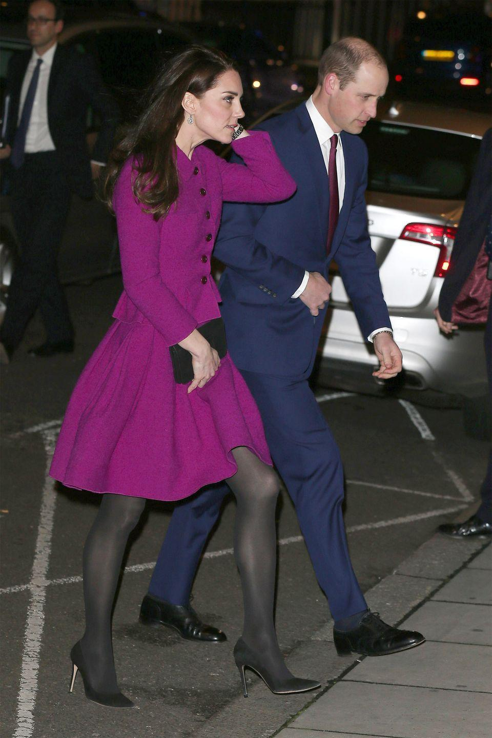 <p>The Duchess of Cambridge wears an Oscar de la Renta purple skirt suit, black tights, black pumps and a clutch while attending the Guild of Health Writers Conference with Prince William.</p>