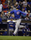 Chicago Cubs' Wilson Contreras reacts after hitting a home run against the Milwaukee Brewers during the fifth inning of a baseball game Friday, April 5, 2019, in Milwaukee. (AP Photo/Jeffrey Phelps)
