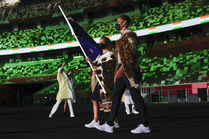 <p>TOKYO, JAPAN - JULY 23: Flag bearers Sarah Hirini and David Nyika of Team New Zealand lead their team out during the Opening Ceremony of the Tokyo 2020 Olympic Games at Olympic Stadium on July 23, 2021 in Tokyo, Japan. (Photo by Jamie Squire/Getty Images)</p>