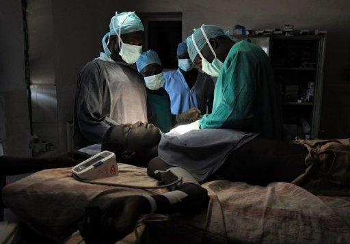 Doctor Evan Atar performs a surgery on a Sudanese youth at the only hospital in Kurmuk region of the Blue Nile state. Atar says he has done seven amputations since war broke out between the Sudanese Armed Forces (SAF) and fighters loyal to the SPLM-North in Blue Nile state last month