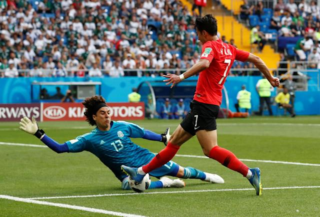 Soccer Football - World Cup - Group F - South Korea vs Mexico - Rostov Arena, Rostov-on-Don, Russia - June 23, 2018 South Korea's Son Heung-min in action with Mexico's Guillermo Ochoa REUTERS/Damir Sagolj