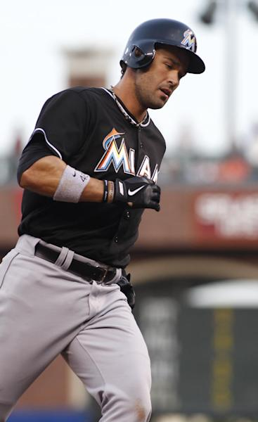Miami Marlins' Garrett Jones rounds third base after hitting a two run homer against the San Francisco Giants during the second inning of a baseball game, Thursday, May 15, 2014, in San Francisco. (AP Photo/George Nikitin)