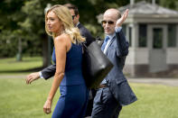 White House Press Secretary Kayleigh McEnany, left, and President Donald Trump's White House senior adviser Stephen Miller, right, walk across the South Lawn to board Marine One with President Donald Trump aboard at the White House in Washington, Thursday, Aug. 6, 2020, for a short trip to Andrews Air Force Base, Md. and then on to Cleveland, Ohio. (AP Photo/Andrew Harnik)
