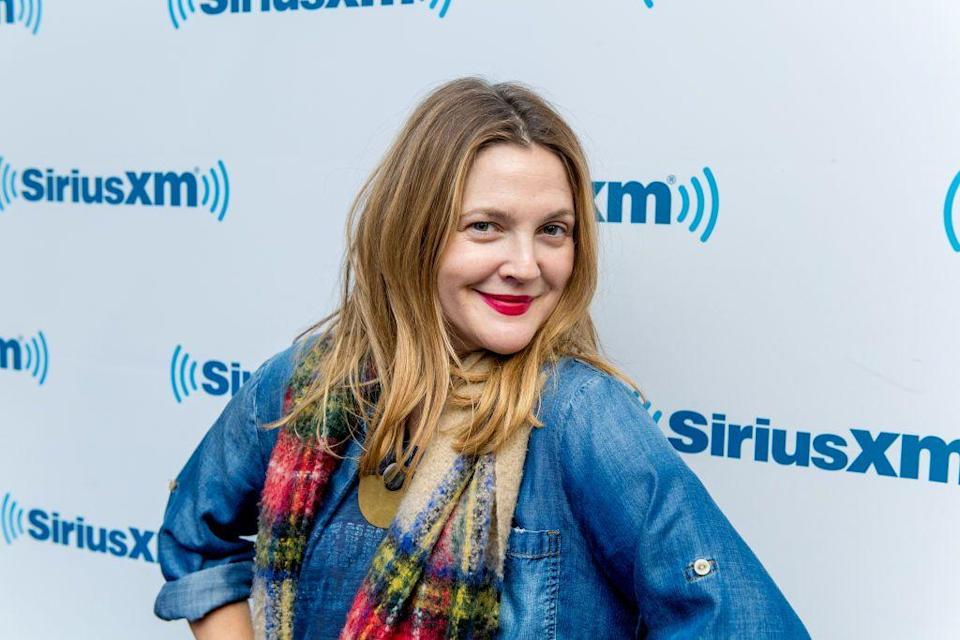 <p>Not quite ready to take the leap to golden blonde? Consider a few shades lighter like this gingery blonde on <strong>Drew Barrymore</strong>. Still vibrant, curly or straight styles will evoke a playful warm feel that's low maintenance.</p>