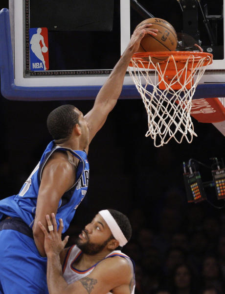 Dallas Mavericks' Brandan Wright dunks on New York Knicks' Rasheed Wallace during the first half of an NBA basketball game Friday, Nov. 9, 2012, in New York. (AP Photo/Frank Franklin II)