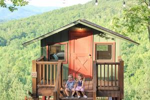 Young campers enjoy the view from a treetop cabin at Yogi Bear's Jellystone Park Camp-Resort in Golden Valley, North Carolina.
