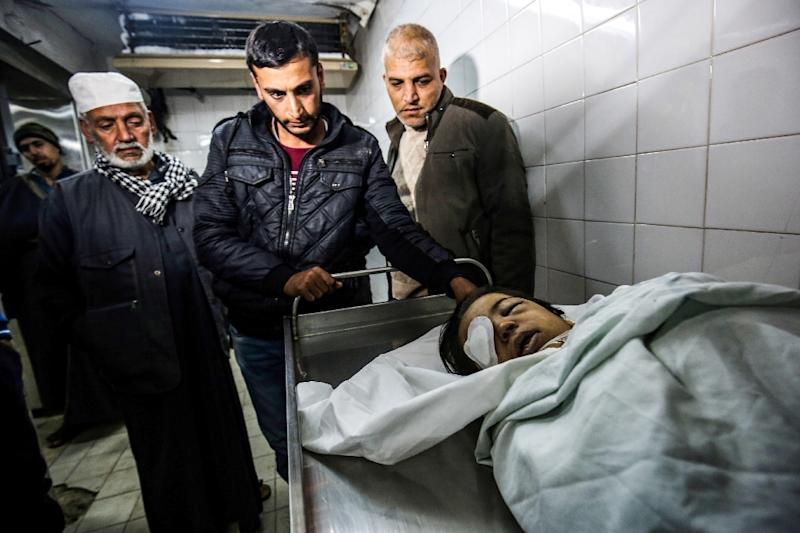 Relatives mourn around body of Palestinian child Ahmed Abu Abed, lying in a hospital morgue in Khan Yunis in the southern Gaza Strip