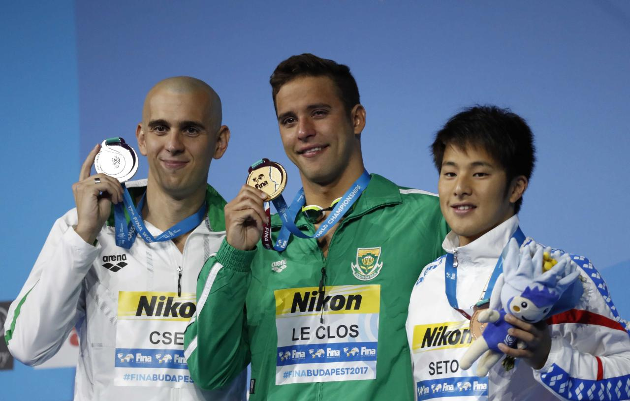 Swimming – 17th FINA World Aquatics Championships – Men's 200m Butterfly awarding ceremony – Budapest, Hungary – July 26, 2017 – (L-R) Laszlo Cseh (silver) of Hungary, Chad Le Clos (gold) of South Africa and Daiya Seto (bronze) of Japan pose with the medals. REUTERS/Laszlo Balogh