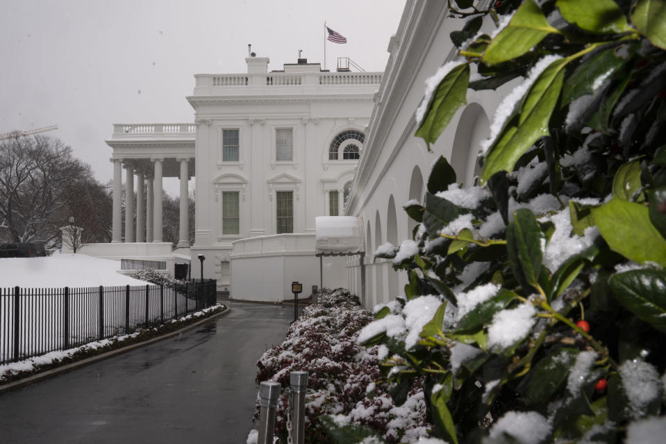 Snow covers the ground at the White House, Tuesday, Feb. 2, 2021, in Washington. (AP Photo/Evan Vucci)